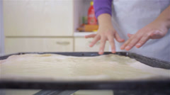 Close up of oiled dough on tray - stock footage