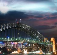 Sunset colors of sydney. the harbour bridge at dusk Stock Photos