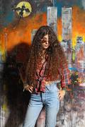 Young girl and graffiti Stock Photos