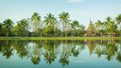 Thailand, sukhothai - a park with a pond and palm trees on the shore Stock Footage