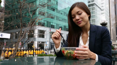 Business woman eating salad on lunch break Stock Footage