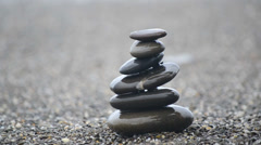 Pyramid of pebbles Stock Footage