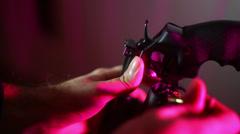 Loading pistol magnum gun hand Stock Footage