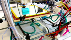 Wide angle of three dimensional printer in a tangle of electric wires. - stock footage