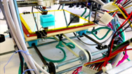 Stock Video Footage of Wide angle of three dimensional printer in a tangle of electric wires.