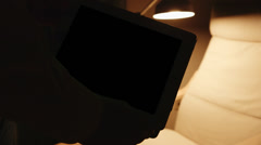 Silhouetted tablet pc with cozy reading place background Alpha channel Stock Footage