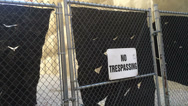 Stock Video Footage of No Trespassing Sign on a Closed Fence Gate 4011