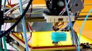 Stock Video Footage of Closeup of prototype of three dimensional handmade printer.