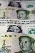 Chinese yuan on american dollar Stock Photos