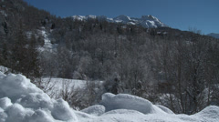 Allos Village Pan of High Village to Chalets Stock Footage