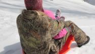 Stock Video Footage of Blonde Woman and Child Sledding in the Snow
