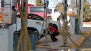 Stock Video Footage of Young Boy Cleans Car Bumper at the Carwash