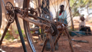 Stock Video Footage of african man behind spokes of bicycle