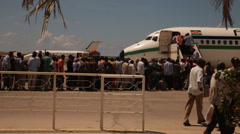 A long line of passengers wait to board a commercial aircraft in Mogadishu, Stock Footage