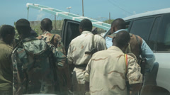 Armed Somali soldiers and policeman in Mogadishu, Somalia Stock Footage