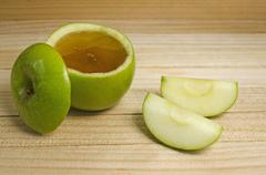 Apple in honey for rosh hashanah Stock Photos