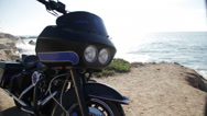 Stock Video Footage of Motorbike is standing on the seashore cliff harley davidson motorcycle beach