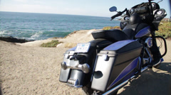 Promoting the new model motorcycle harley division by the pacific ocean Stock Footage