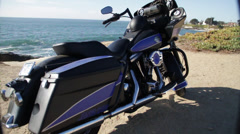 A New Model Motorbike is standing on the seashore Stock Footage