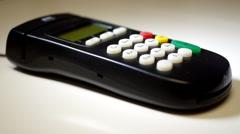 Credit card swipe through terminal Stock Footage