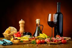 Traditional spanish tapas and red wine Stock Photos