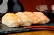 Stock Photo of nigiri sushi with prawns and soy sauce