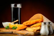 Stock Photo of fish and chips with cola drink