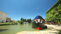 Large floating barge on June 22, 2013 in Le Somail on the Canal du Midi, France. Stock Footage