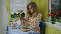 Woman prepare herb cornflower healthy tea and mix Stock Footage