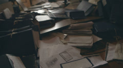 Documents are scattered on the floor after robbery - stock footage