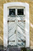 Wooden white door with wrought-iron hinges Stock Photos
