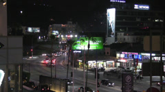 Traffic on Highland and Franklin at Night Stock Footage