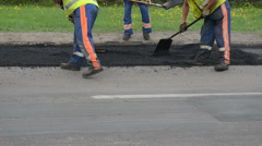 Workers put hot asphalt street holes heavy vibration roller Stock Footage