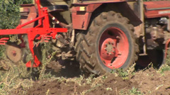 Move the tractor to a new furrow - stock footage