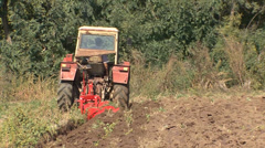 Tractor doing furrow for planting - stock footage