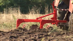 Tractor equipment plow trench furrow - stock footage