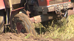 Old tractor working in the field - stock footage