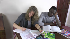Attractive student friends studying at home. One is bored. Stock Footage