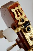 Head guitar neck with tuning pegs Stock Photos