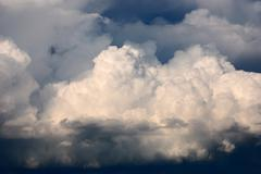 Cumulus clouds illuminated by the sun Stock Photos