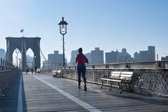new york city the pedestrian walkway along the brooklyn bridge - stock photo