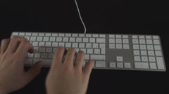 Hand Typing Chapter I On A White Keyboard Point Of View-Shot Stock Footage