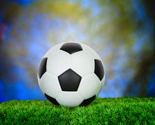 Soccer football on green grass field use for sport competition background Stock Photos