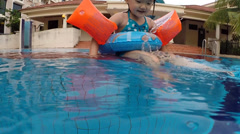 Little girl swimming at swimming pool Stock Footage