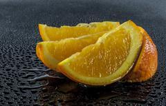 Orange on black Stock Photos