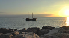 Pirate ship on open sea sunset Stock Footage