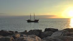 Pirate ship on open sea sunset - stock footage