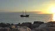 Stock Video Footage of Pirate sail boat on open sea sunset