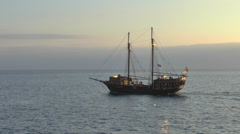 Pirate ship on open sea at sunset - stock footage