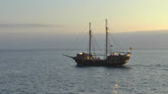 Stock Video Footage of Pirate ship on open sea at sunset